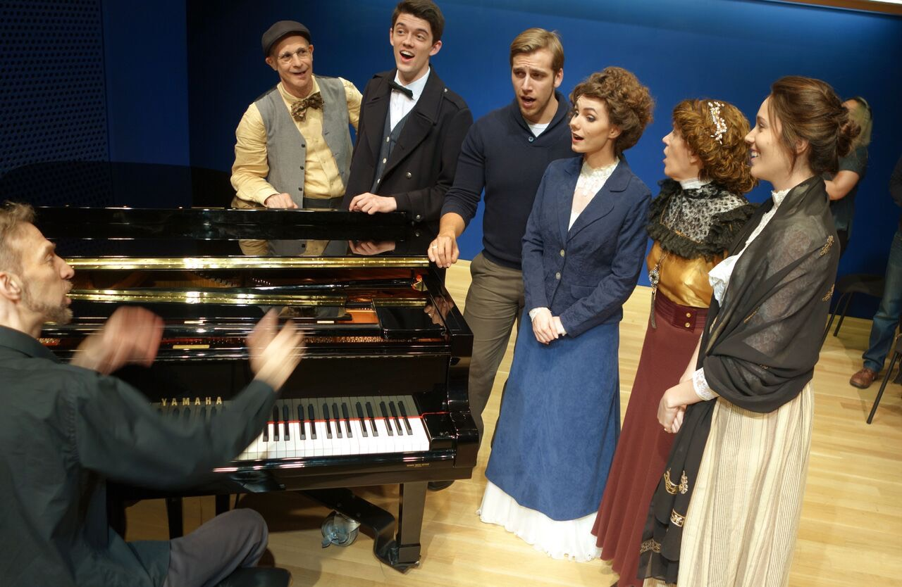 Gregory Nissen at piano with cast of MARTIN EDEN